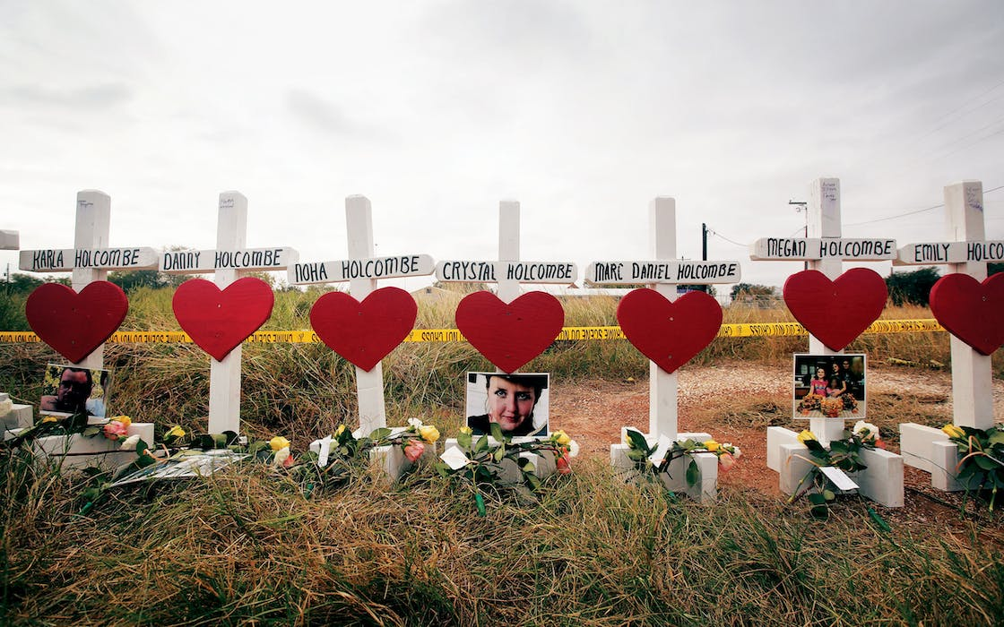 Crosses for the Holcombe family and others sit just outside crime scene tape along Highway 87 near the First Baptist Church of Sutherland Springs to honor the 26 victims killed there on November 5, 2017.
