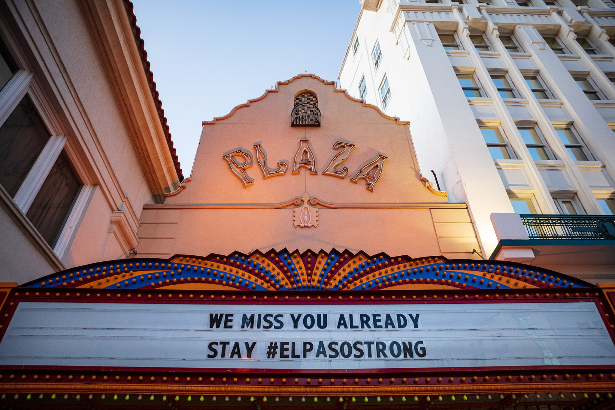 Rather than featuring upcoming acts, the marquee on El Paso's historic Plaza Theatre offers encouragement.