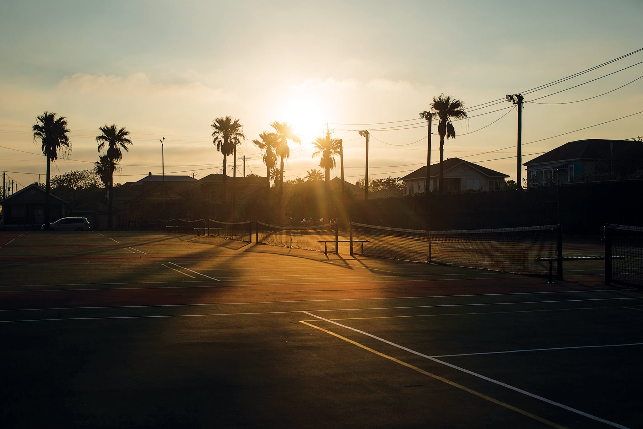 Tennis courts go unused at Menard Park, in Galveston, which began closing public spaces, including beaches, in late March.