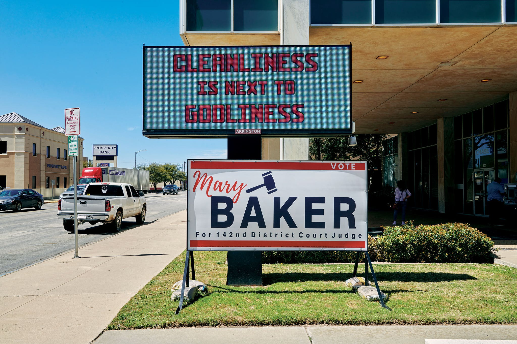 A sign outside Chase Bank, on Midland's Wall Street, on March 25. The Brookings Institution listed Midland and Odessa as two of the top five U.S. metro areas most threatened by the virus's economic effects.