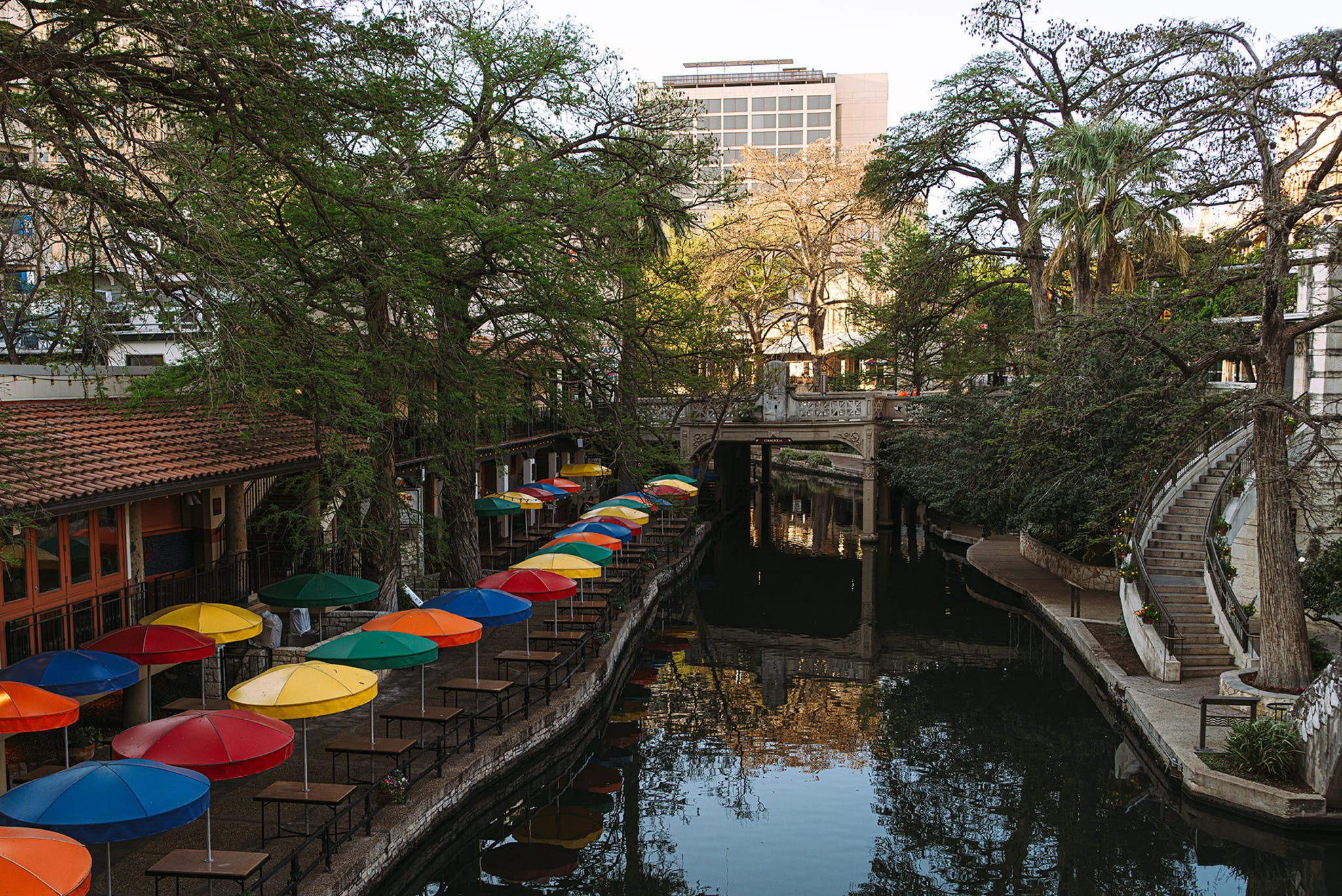 The San Antonio River Walk sits mostly empty, and its waters have begun running unusually clear.