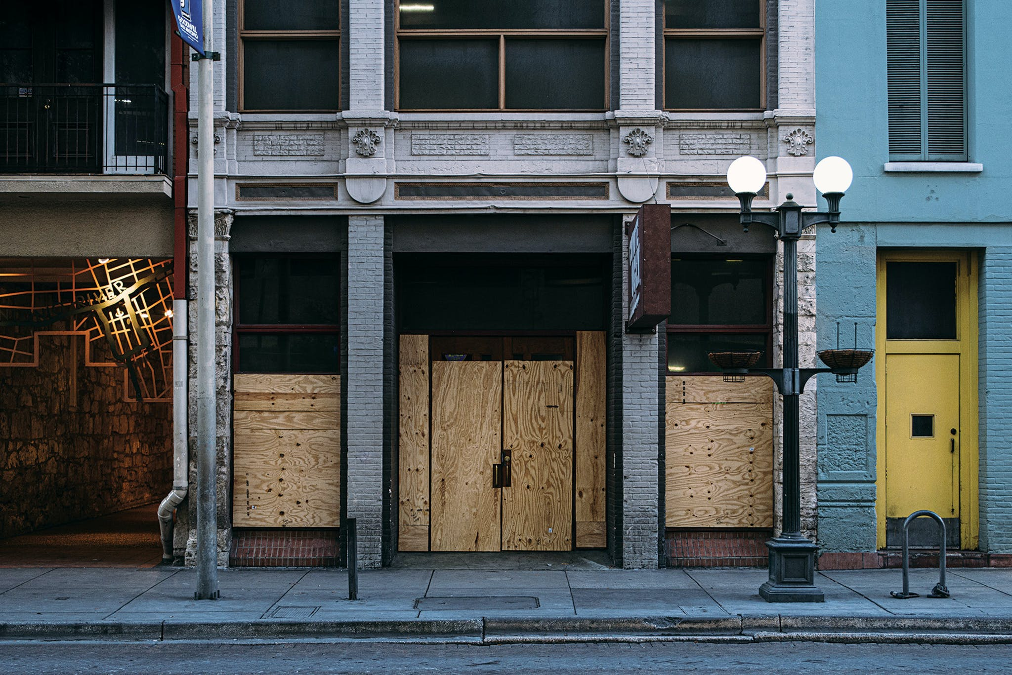 In downtown San Antonio, as in other cities, many shuttered businesses took precautions to prevent vandalism.