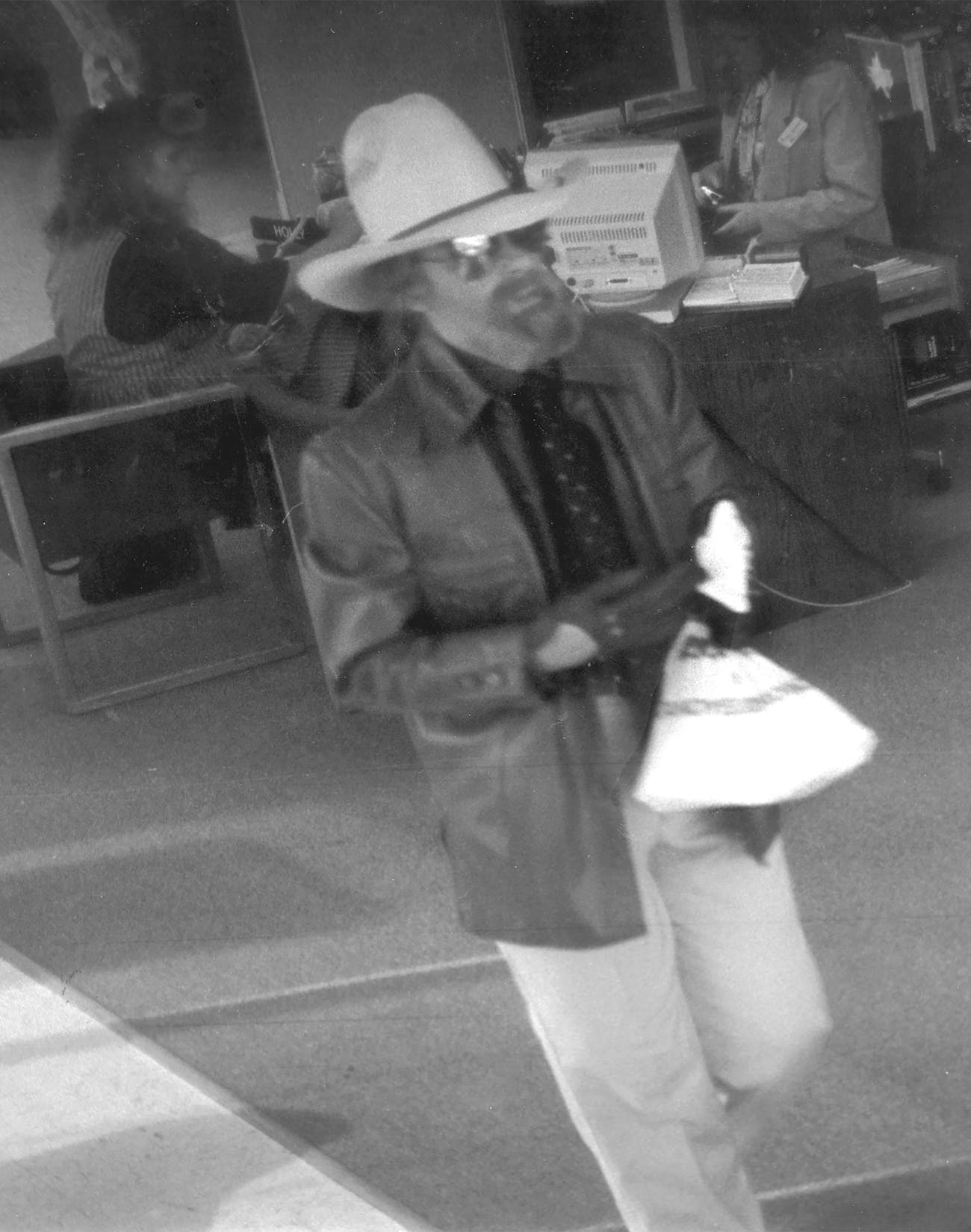 A surveillance camera captured Peggy Jo Tallas, wearing men's clothes and a fake beard, during a robbery in 1992.