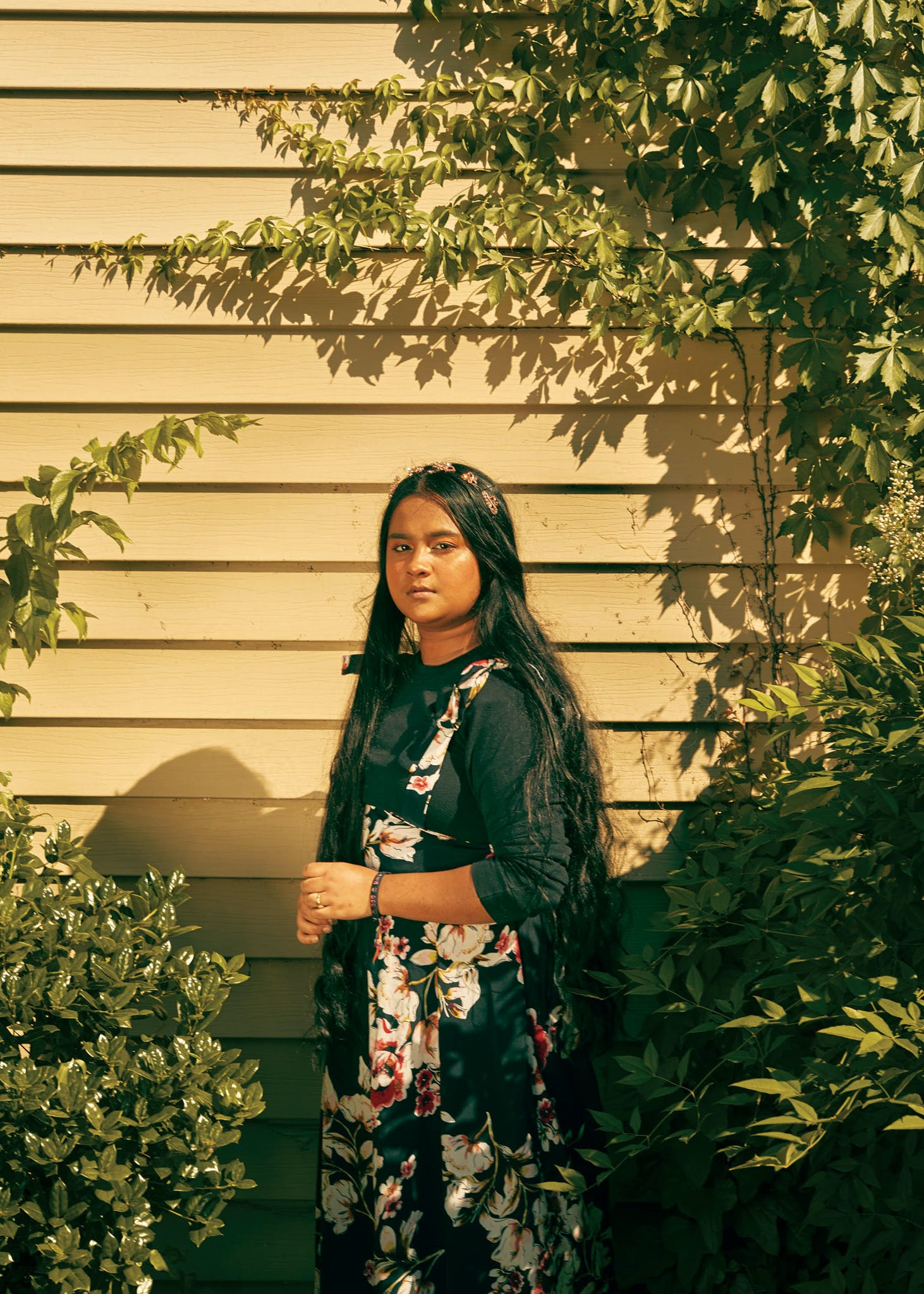 """Every time the jasmine plant blooms in their backyard, Twa Bee's mother picks the flowers and weaves them into a crown. """"We'll wear it on our heads, or you can wrap around your bun or braid it in your hair,"""" Bee, 18, explains. Jasmine reminds them of Thailand, where Bee was born, though her family is originally from Burma. """"There's a lot of jasmine in Thailand, so it's really, really pretty. My mom and other people from Thailand have it here because it makes them feel at home and it smells really good."""" When Bee moved to Dallas, she started participating in Eagle Scholars, a college readiness program, where she discovered that her passion was to become an immigration lawyer. Though Bee wasn't planning on attending prom, she couldn't wait for her graduation from Emmett J. Conrad High School. """"I worked so hard to graduate, and now it's cancelled,"""" she says. """"They're having this virtual thing, which isn't really a graduation. I wanted to walk the stage."""" She hopes to attend the University of Texas at Arlington and major in political science before attending law school. Due to the coronavirus, however, """"Some scholarships have been reduced, so it kind of sucks because there's less money for us."""""""