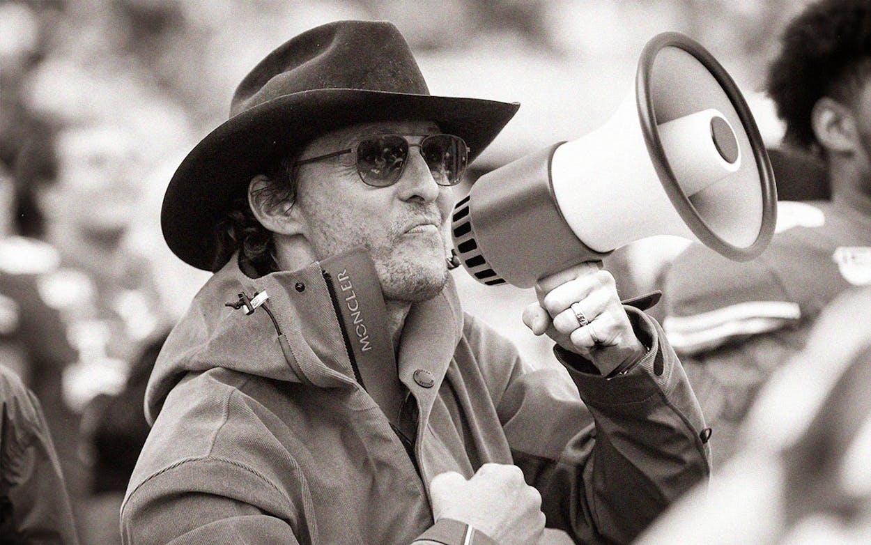 Mathew mcnaughey holding megaphone
