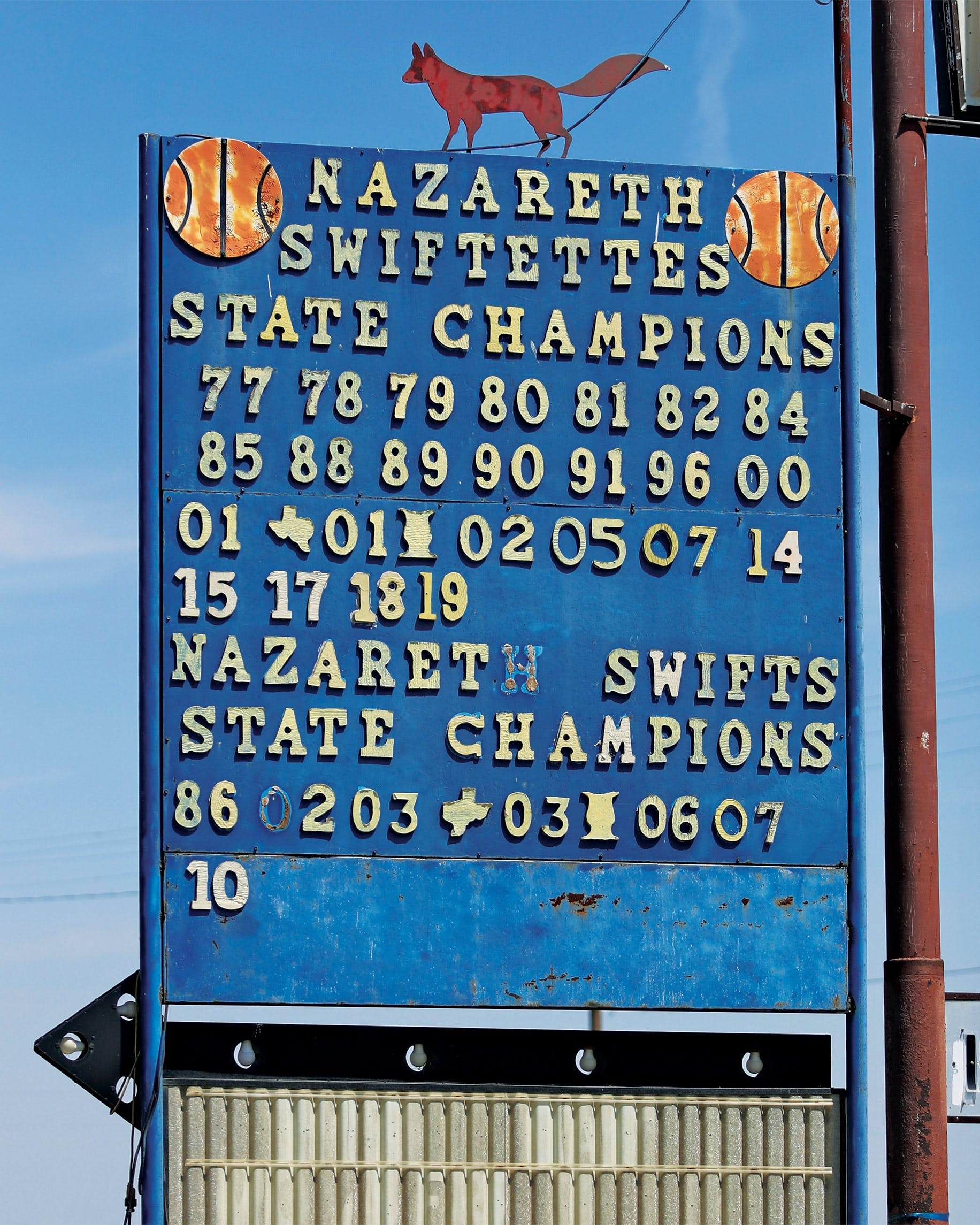 A sign in downtown Nazareth, touting the Swiftettes' and Swifts' state championships.