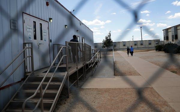 migrants outside of detention center