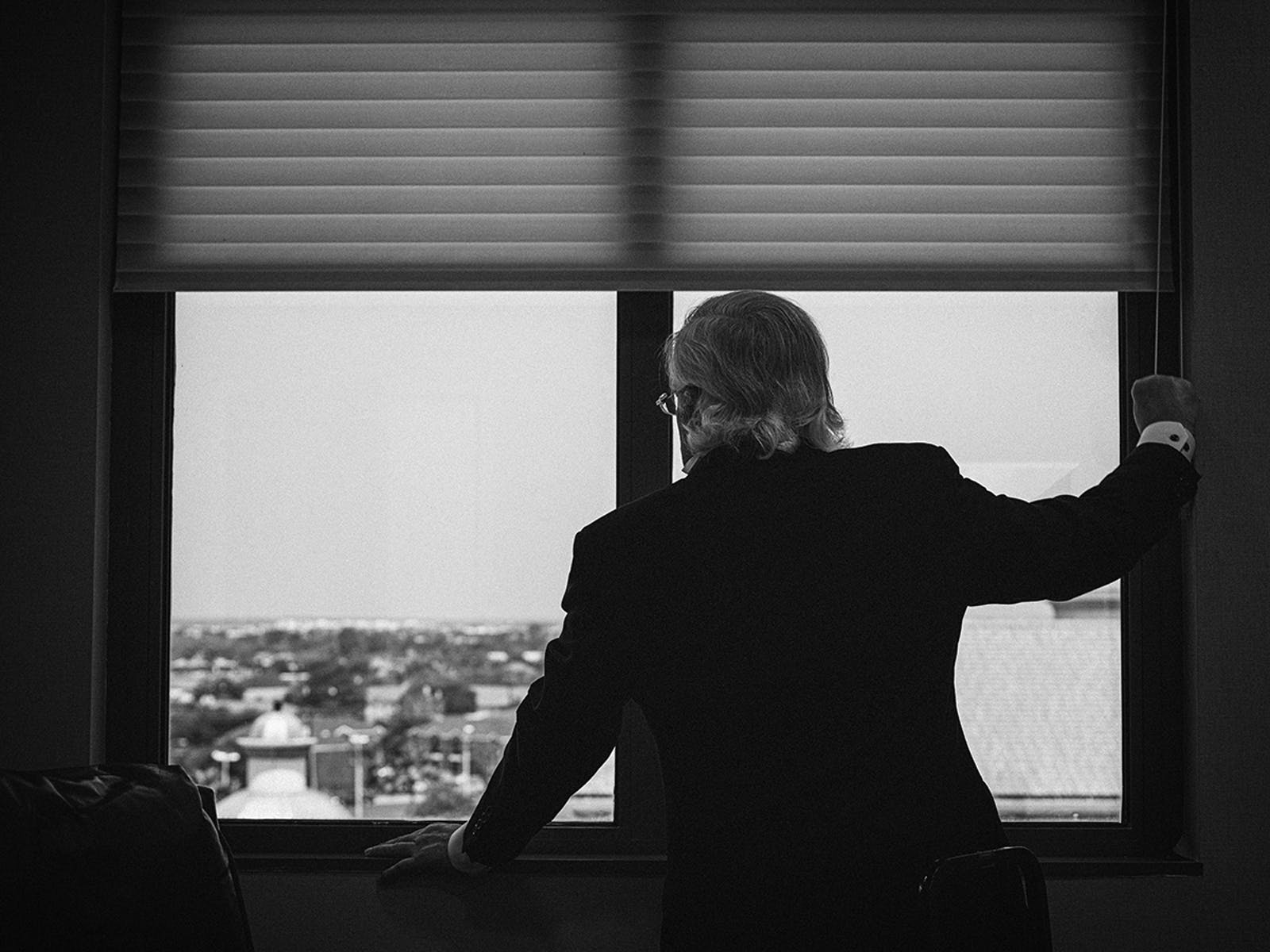 Ricardo Cigarroa looks out the window in his office at the Laredo Medical Center in Laredo, on April 28, 2020.
