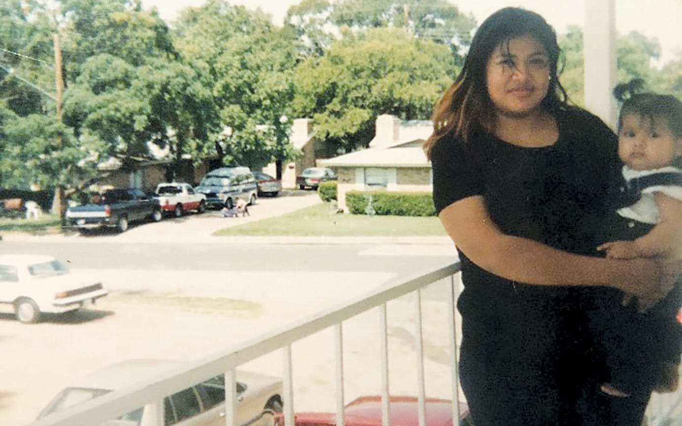 Jimenez holds her daughter, Brenda, in Austin, circa 2002