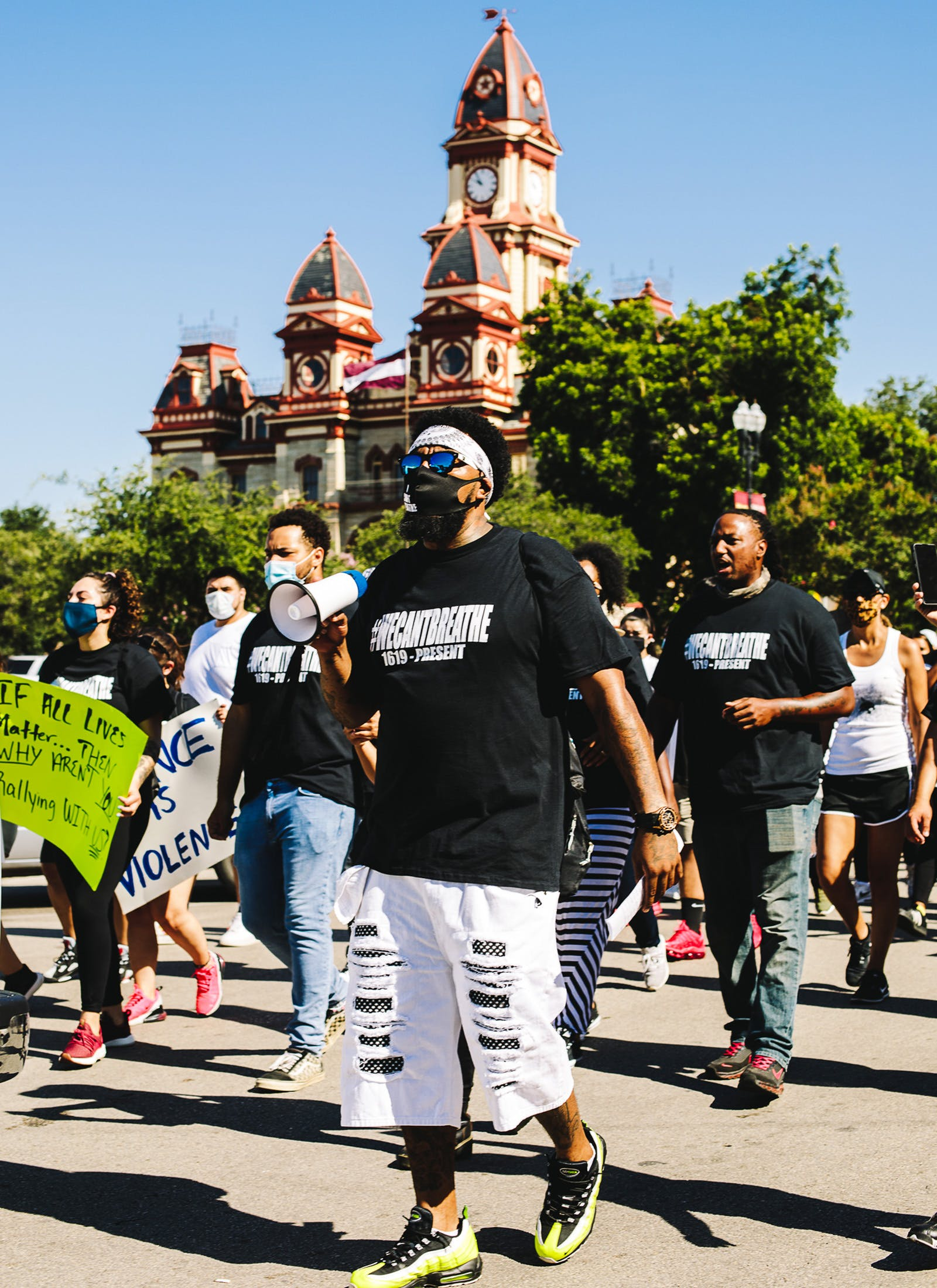 Joe Rollins leads protesters in a chant near Lockhart's historic courthouse building during a civil rights march celebrating the life of George Floyd on Saturday, June 13.