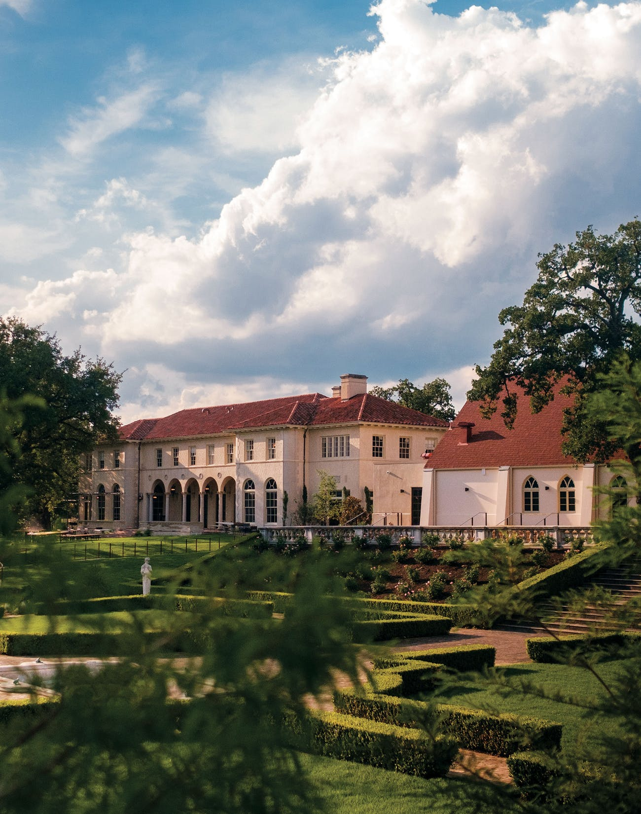 The Commodore Perry mansion, built in 1928 near Austin's Hyde Park neighborhood, is listed on the National Register of Historic Places. For its new chapter as a luxurious place to stay—Auberge Resorts Collection's first urban retreat—the dreamy grounds have been updated with fresh landscaping, a new pool, and the addition of a three-story Inn.