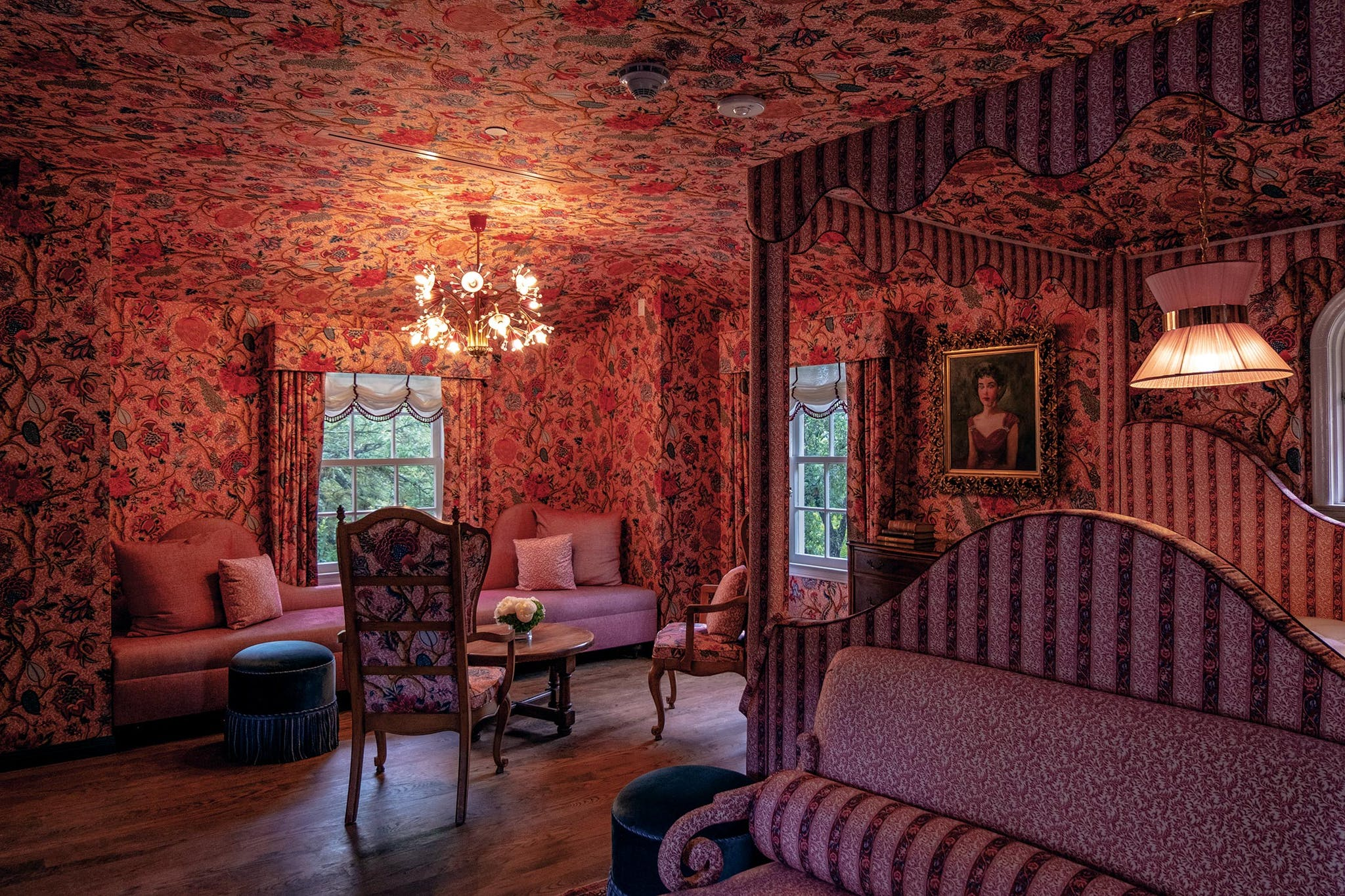 In the mansion, Fulk gave each of the five guest rooms its own personality with custom and archival Pierre Frey textiles. Fulk designed this all-pink suite, with a flowering branch pattern on the ceiling and walls, in honor of one of the mansion's previous owners, a woman called LaVerne who preserved the estate in the forties.