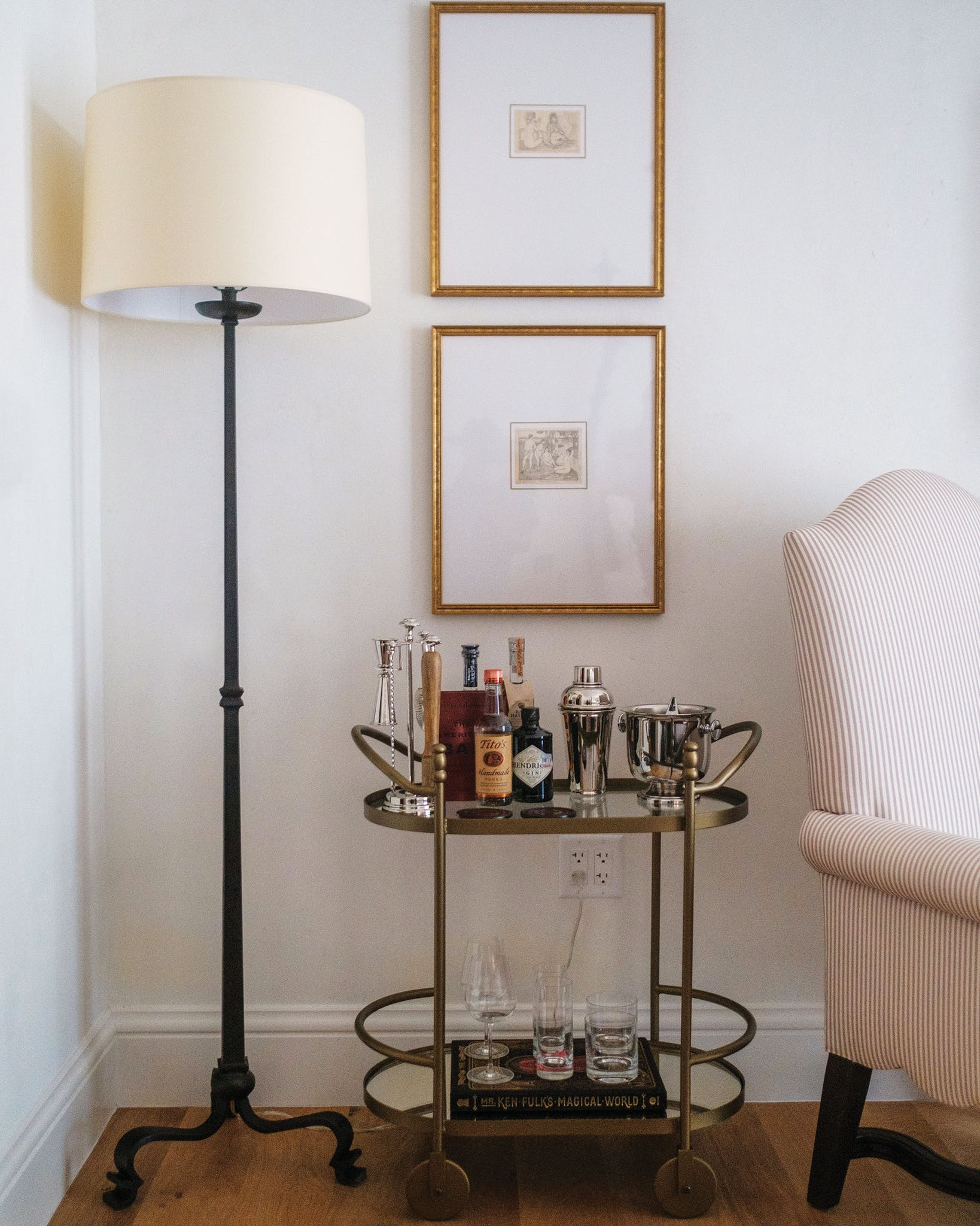 Each room is furnished with a classic, 1920s-style bar cart—featuring libations handpicked to please each guest's unique tastes—and a heavy dose of Old World charm. Notice the imperfections on the wall beyond: layered with plaster and pleasingly uneven, they echo the time-tested character of the original Italian Renaissance Revival mansion.