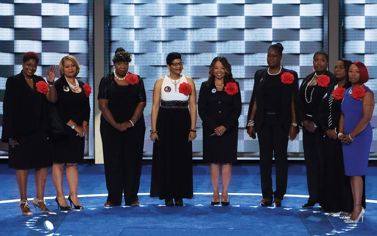 Mothers of the Movement (L-R) Maria Hamilton, mother of Dontre Hamilton; Annette Nance-Holt, mother of Blair Holt; Gwen Carr, mother of Eric Garner; Geneva Reed-Veal, mother of Sandra Bland; Lucia McBath, mother of Jordan Davis; Sybrina Fulton, mother of Trayvon Martin; and Cleopatra Pendleton-Cowley, mother of Hadiya Pendleton; Lezley McSpadden, Mother of Mike Brown and Wanda Johnson, mother of Oscar Grant; and Lezley McSpadden, Mother of Mike Brown stand on stage prior to delivering remarks on the second day of the Democratic National Convention at the Wells Fargo Center in Philadelphia, Pennsylvania on July 26, 2016.