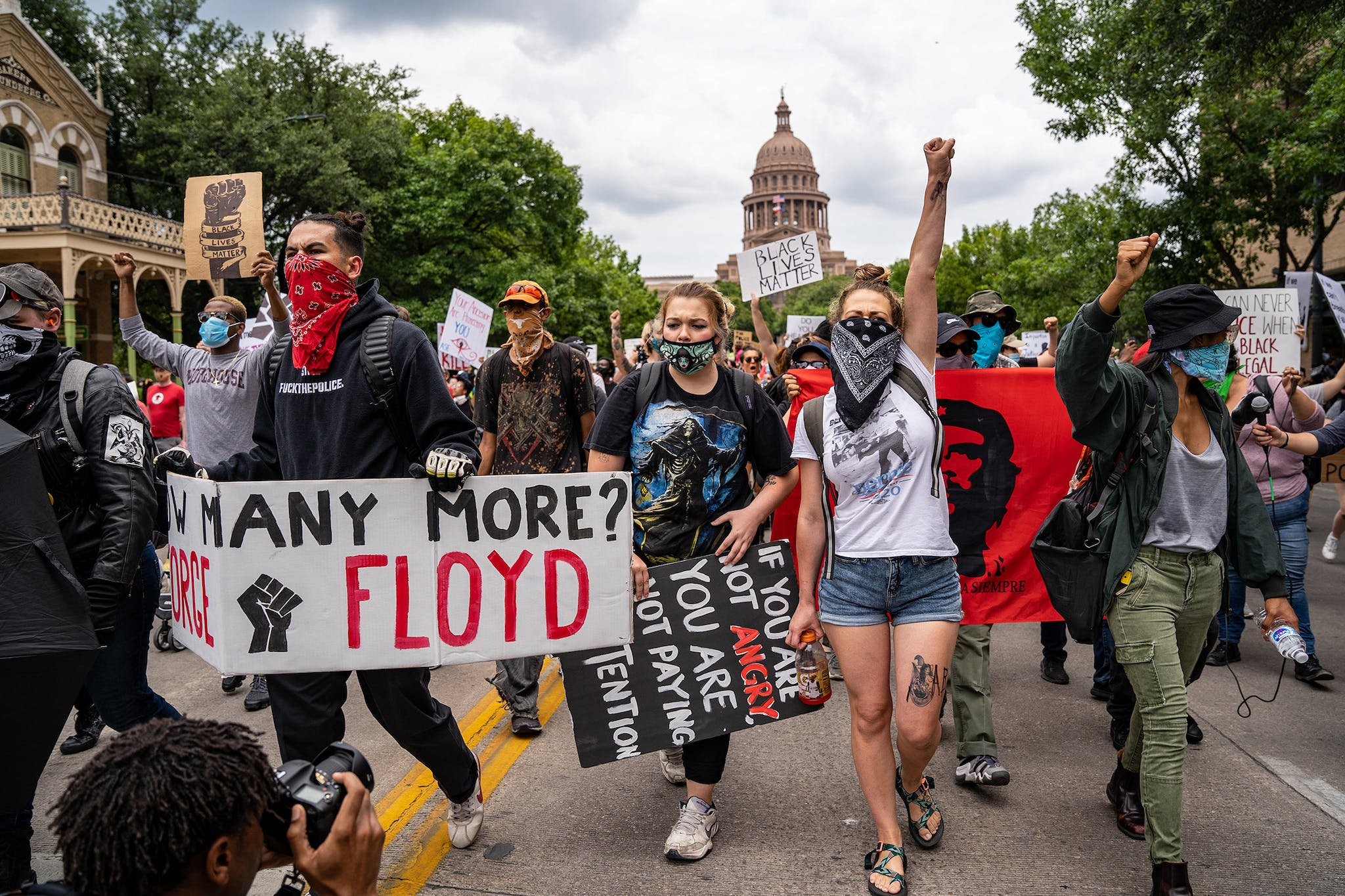 Protesters march on Congress Avenue in Austin on May 31, 2020, after the killing of George Floyd, an unarmed black man in Minnesota, sparks nationwide outrage.