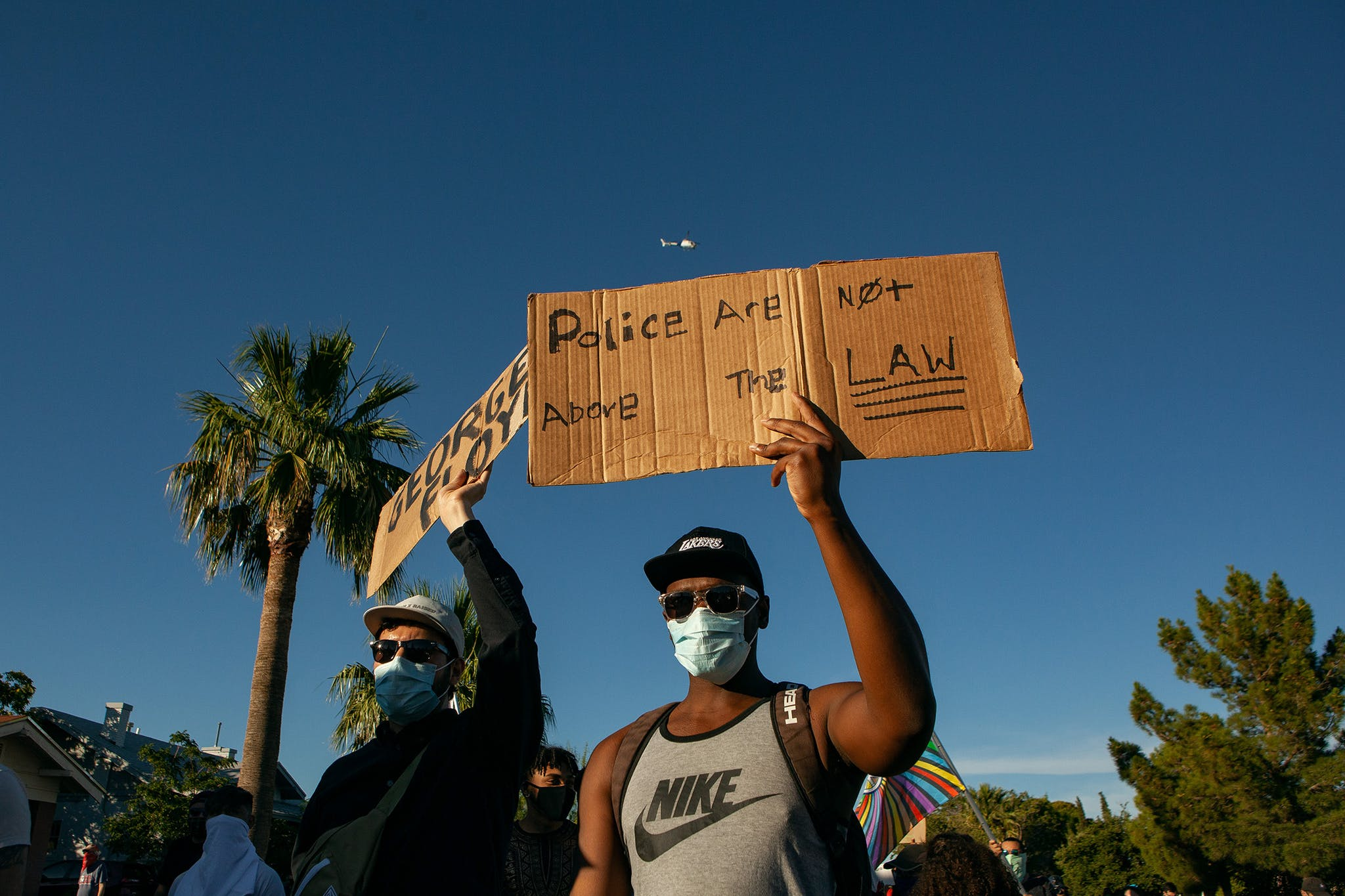 Protesters begin a march from Memorial Park to police headquarters in El Paso on May 31, 2020. A Customs and Border Patrol helicopter provided surveillance during the protest against police brutality.