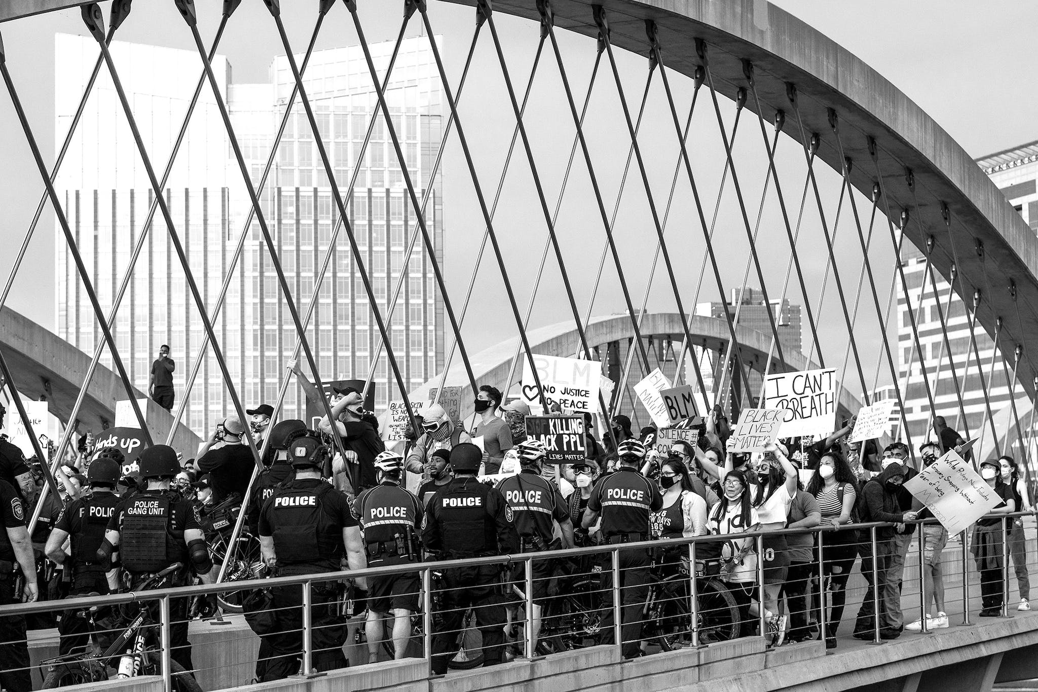 Protesters face the police blockade on the Trinity Bridge in Fort Worth on May 31, 2020.