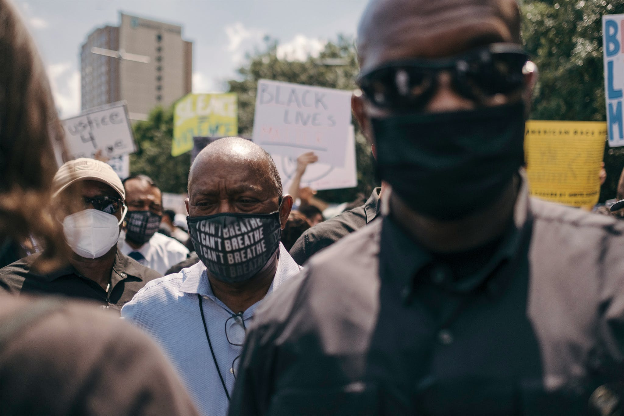 """Mayor Sylvester Turner wears an """"I Can't Breathe"""" mask during a march to honor the memory of George Floyd in downtown Houston on June 2, 2020."""