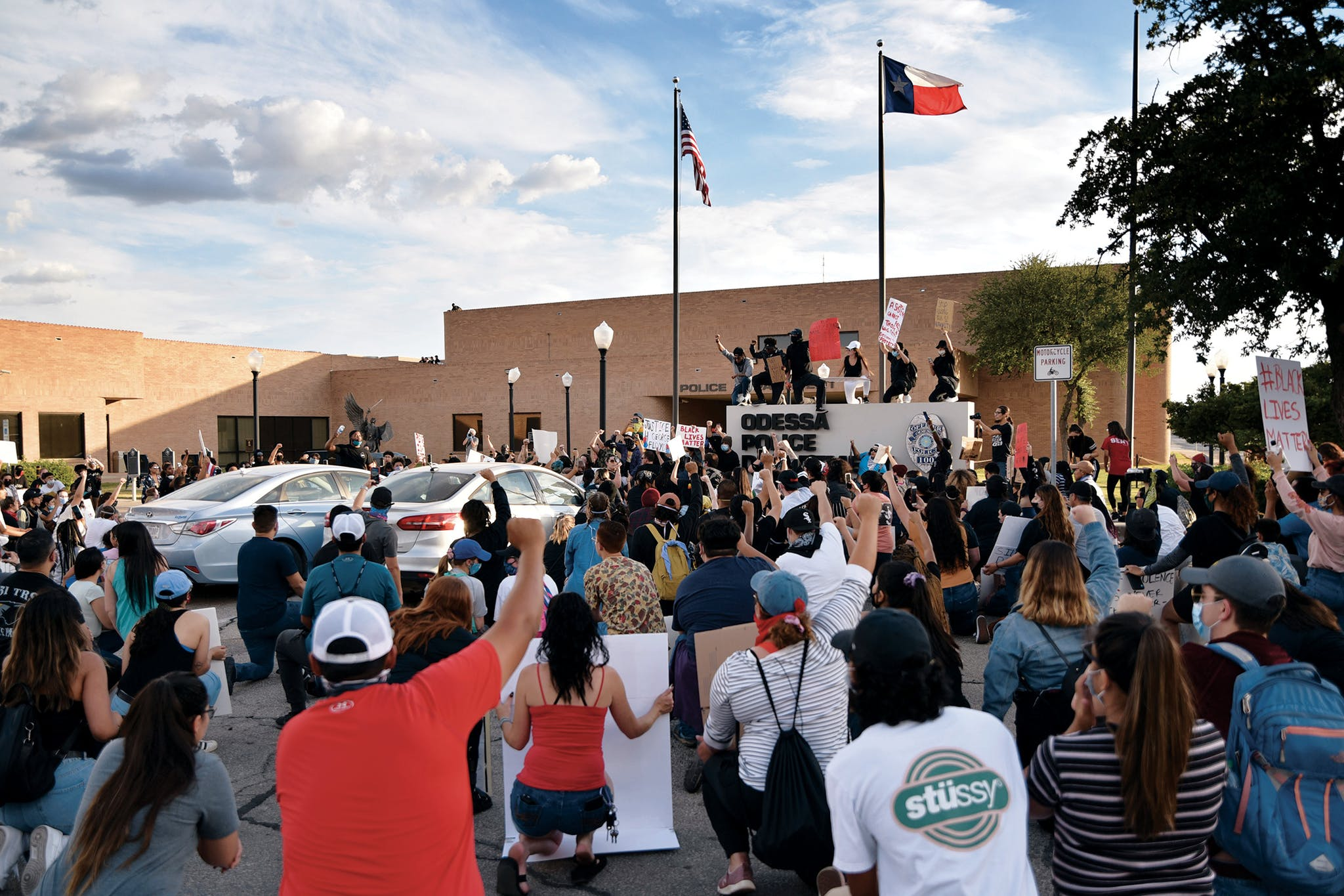 Protesters take a knee outside of the Odessa Police Department during a Black Lives Matter protest in Odessa on May 31, 2020, following the death of George Floyd on May 25.