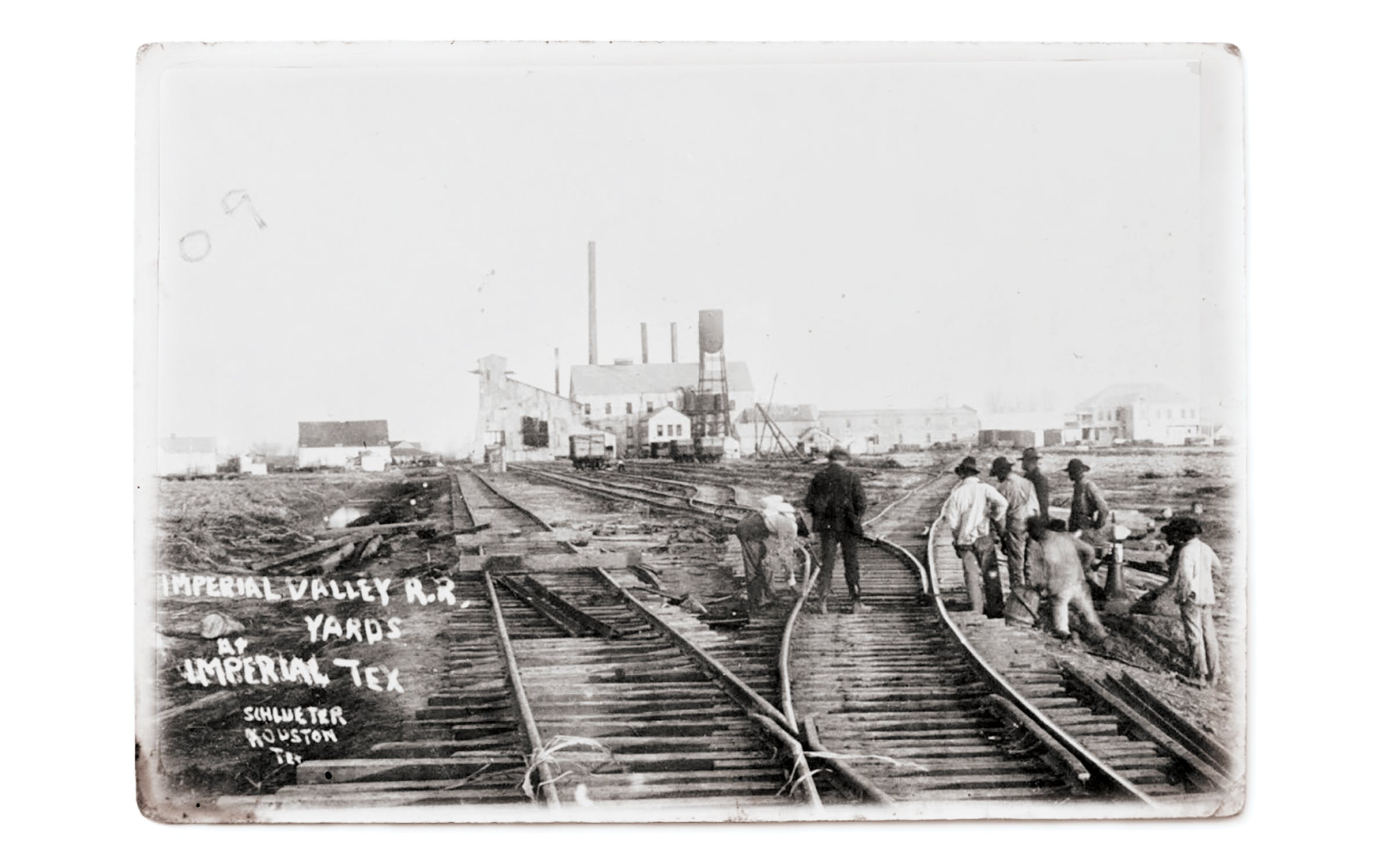 A crew repairing Sugar Land Railroad lines in 1909. (The mill can be seen in the distance.)