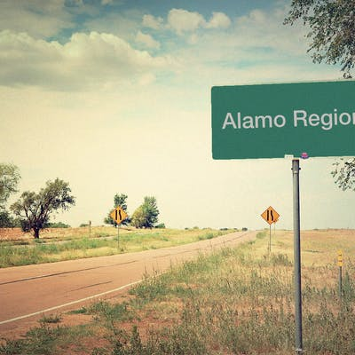 """country road with """"alamo region"""" sign"""