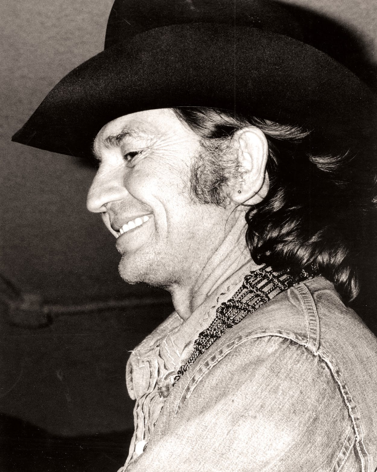Country singer/songwriter Willie Nelson performs onstage in circa 1974.