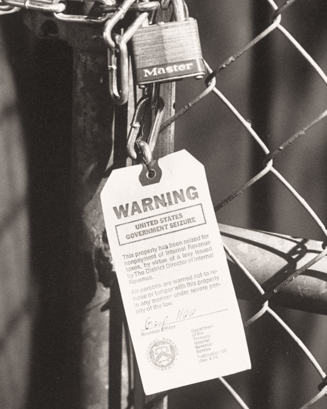 The chain-link fence at Willie's country club, padlocked by the IRS.