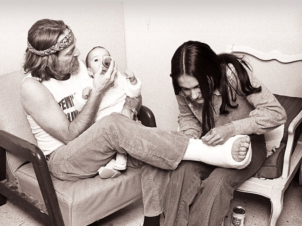 Willie with his granddaughter Rachel and his daughter Lana in one of the Opry House's back rooms in 1977.