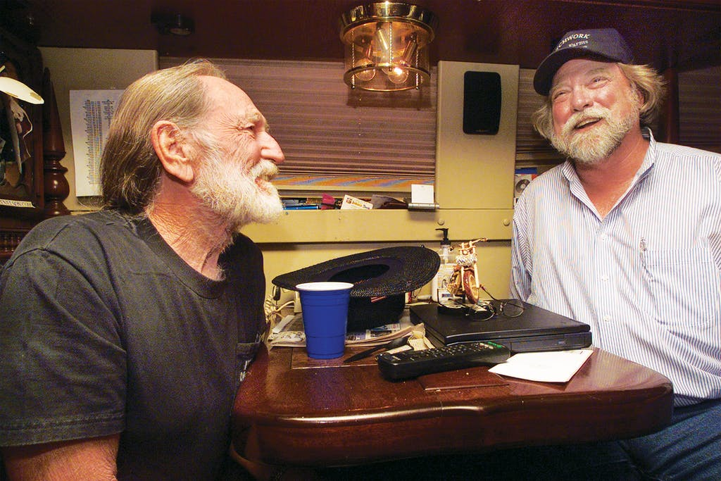 Willie and Roger Allison, a farmer and the director of the Missouri Rural Crisis Center, on Willie's bus in Columbia, Missouri, on May 12, 2003.