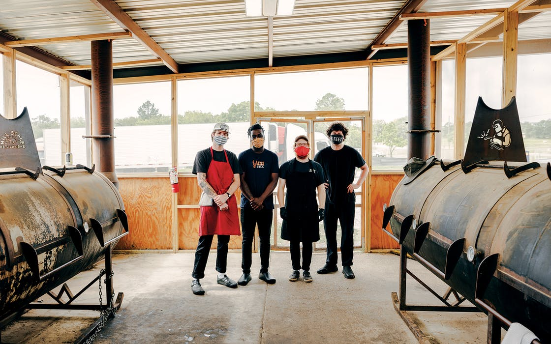 Dylan Taylor, Jalen Heard, Lane Milne, and Jonny White in the pit room of Goldee's Barbecue, in Fort Worth, on June 26, 2020