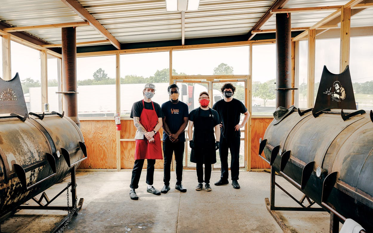 Dylan Taylor, Jalen Heard, Lane Milne, and Jonny White in the pit room of Goldee's Barbecue, in Fort Worth, on June26, 2020