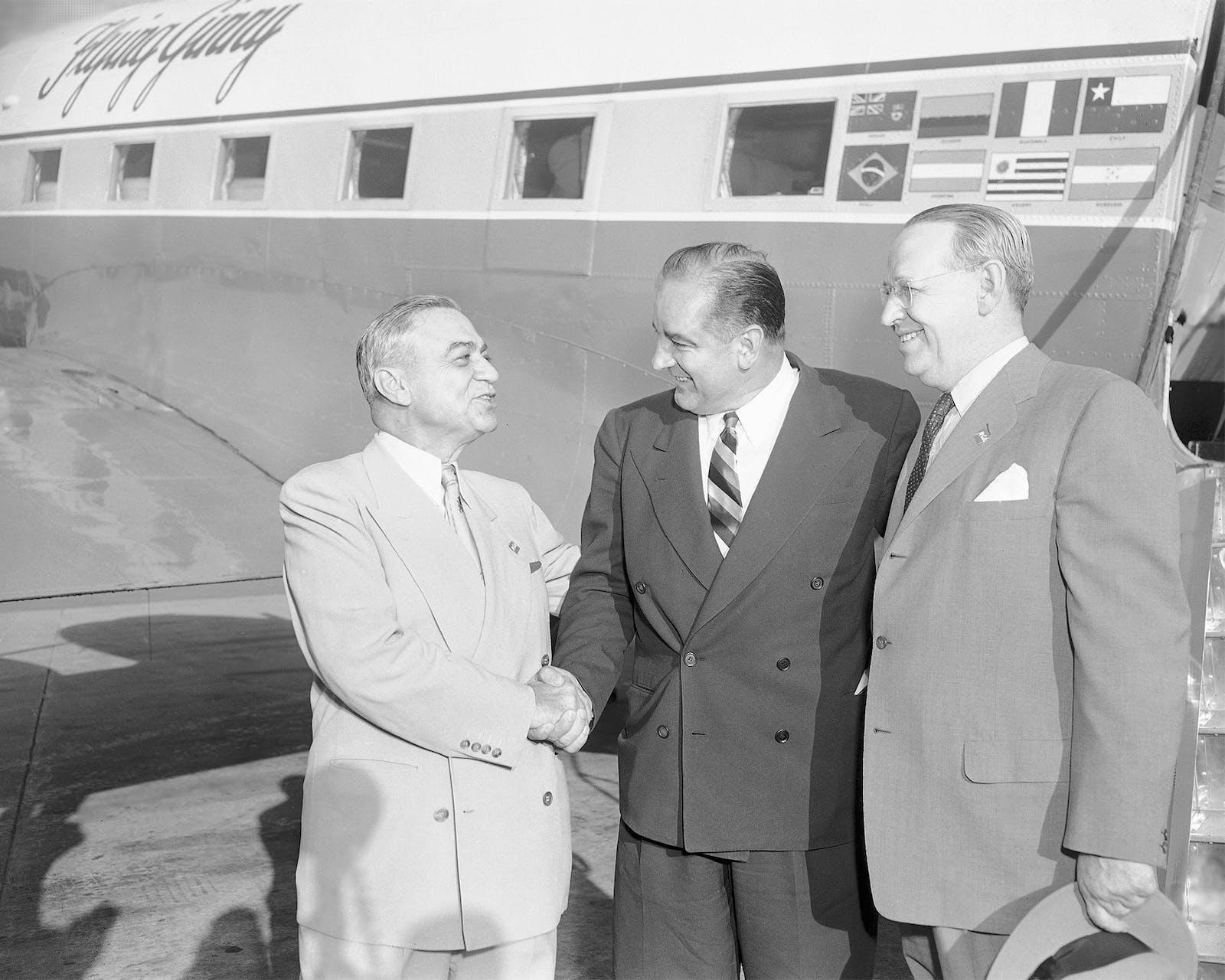 Houston oil man R.H. Abercrombie, left, and Houston banker William A. Smith, right, greet Sen. Joseph McCarthy in Houston on April 20, 1954.