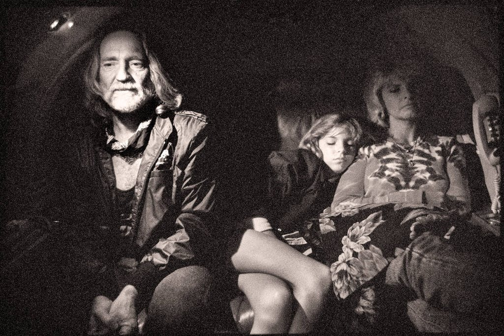 Willie, his wife Connie, and one of their daughters flying on a private plane to the first Farm Aid concert, in Champaign, Illinois, on September 21, 1985.