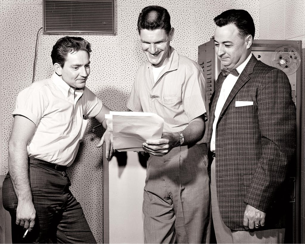 Willie Nelson (left) and fellow songwriter Harlan Howard with their boss Hal Smith, the owner of the Pamper Music publishing company, on July 15, 1961.