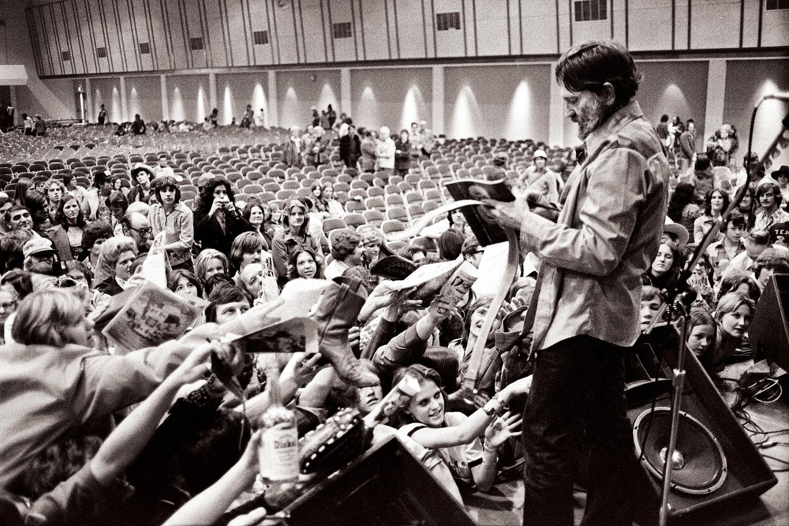 Willie signing autographs after a show in Waco in February 1977.