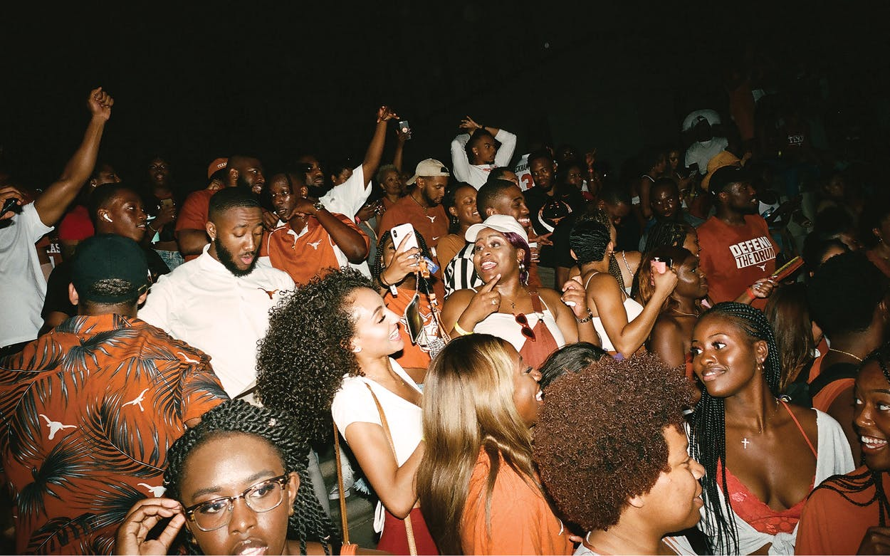 Students and alumni celebrating at the annual Black Homecoming in front of the Tower, at the University of Texas at Austin, in fall 2019.