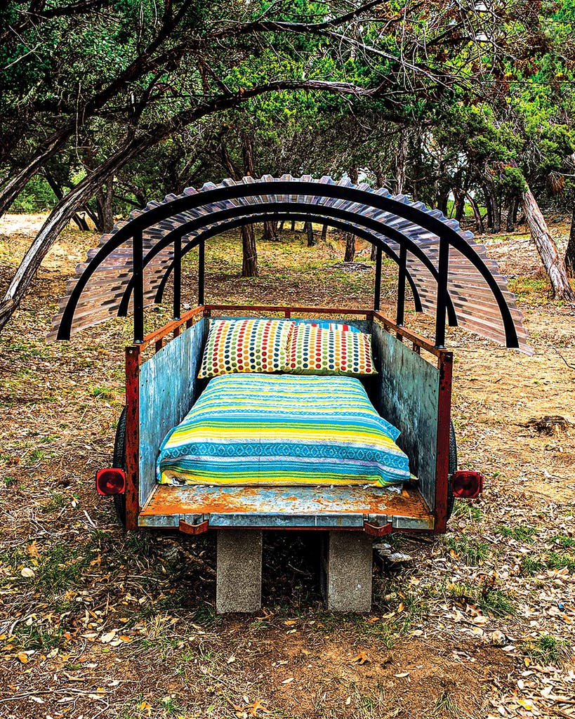 An old wagon serves as a daybed at Seco Ridge Campground, in Utopia.