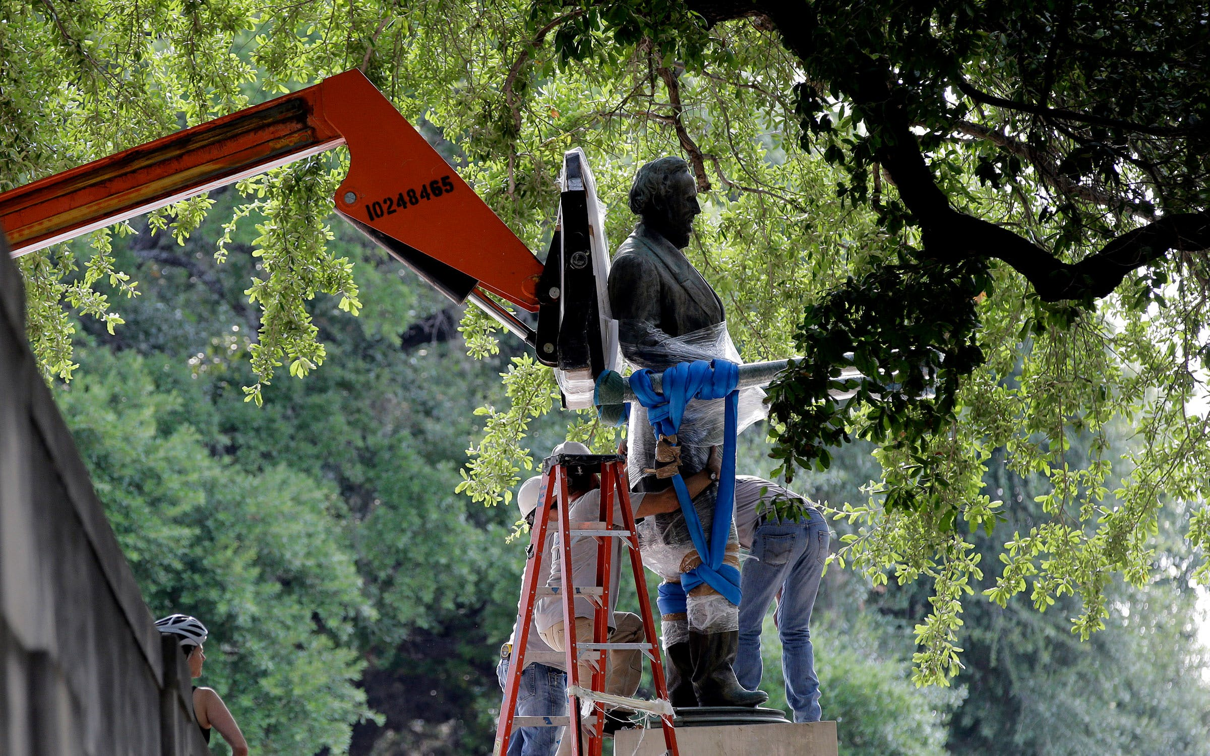 A statue of Confederate president Jefferson Davis being removed from the South Mall at the University of Texas at Austin