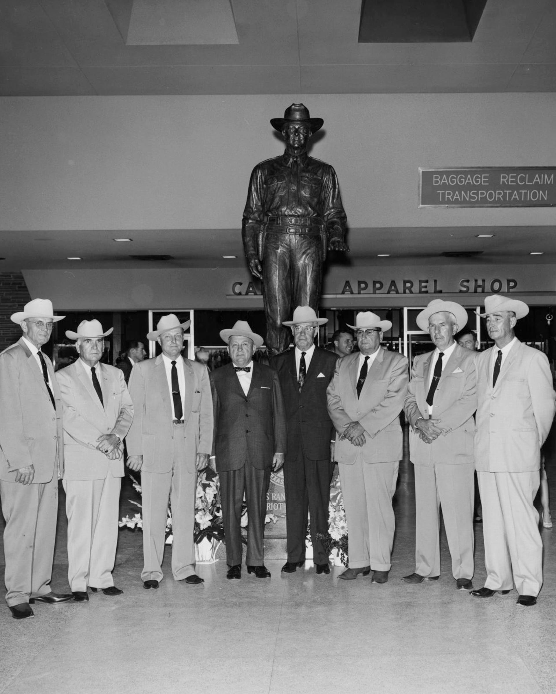 Eight Texas Rangers attending the unveiling of the Texas Ranger of Today sculpture, at Dallas Love Field
