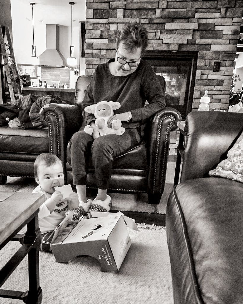 The author's mother, Deborah Zamora, plays with his daughter, Zamora, in late January.