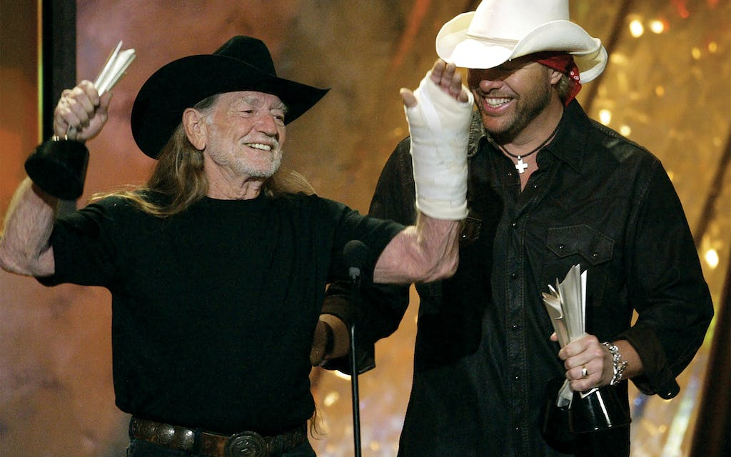"Willie and Toby Keith accept the video of the year award for their song ""Beer for my Horses"" at the 39th annual Academy of Country Music Awards in Las Vegas on May 26, 2004."