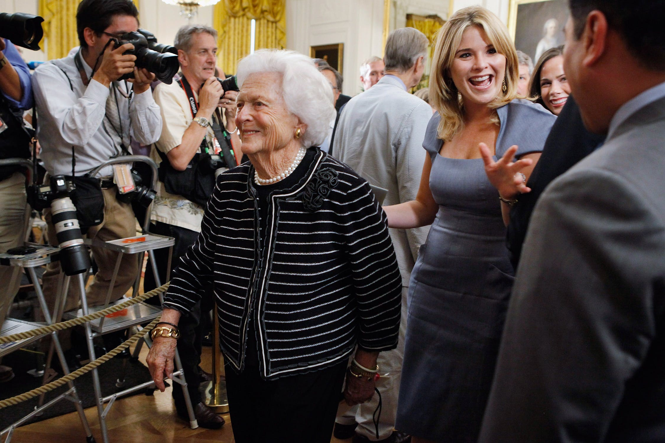 Barbara Bush and granddaughter Jenna Bush Hager walking through a crowd at the White House