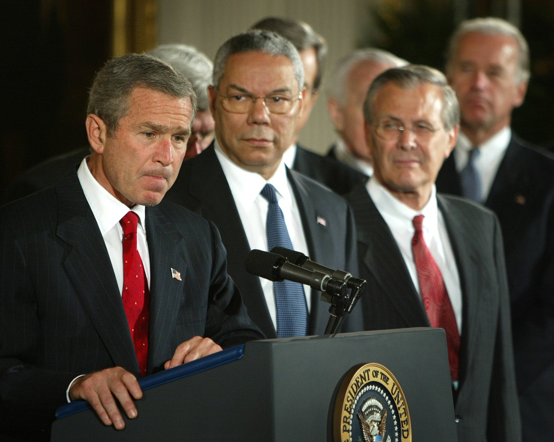 President Bush with Colin Powell and Donald Rumsfeld speak about authorizing the use of force against Iraq