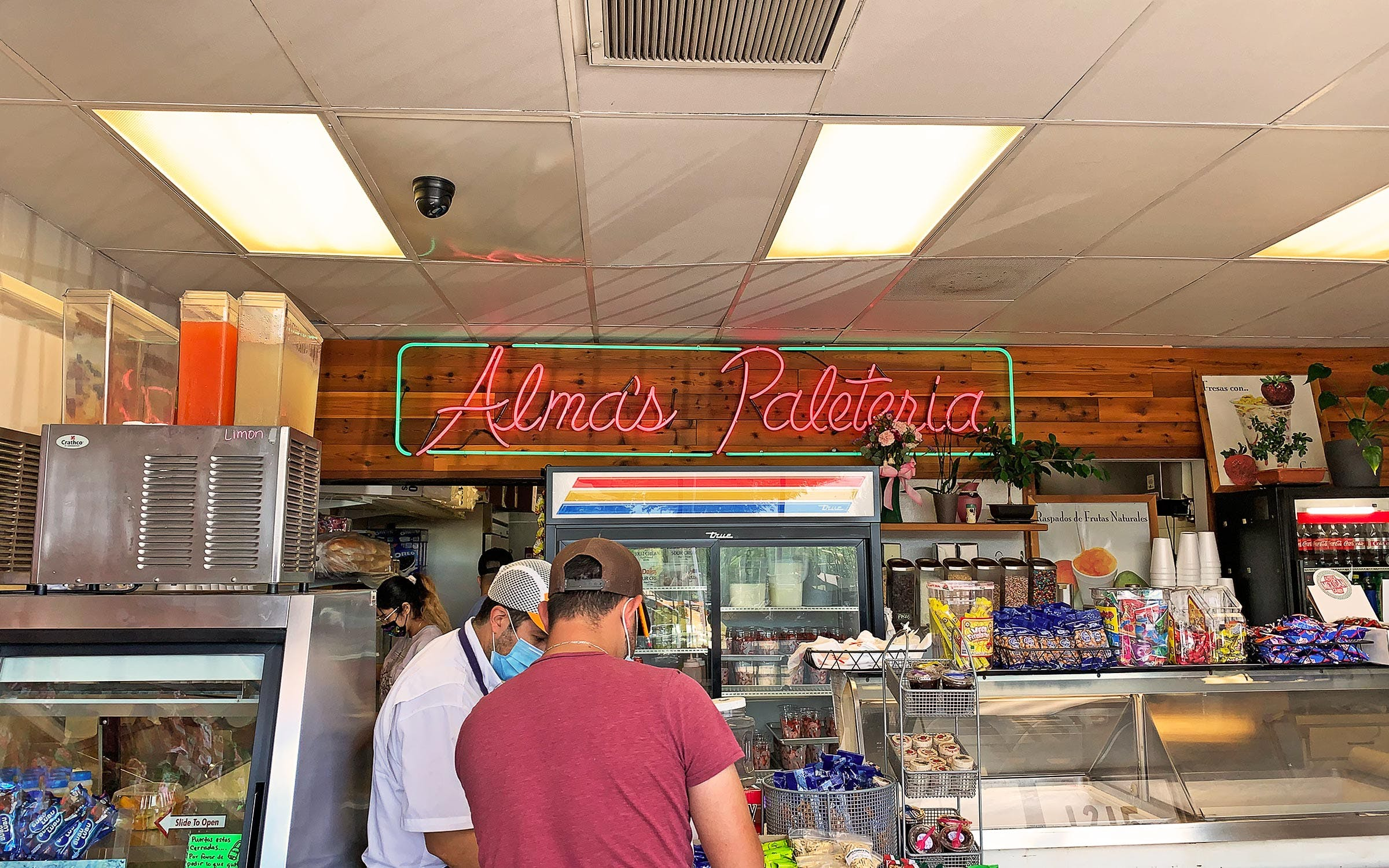 alama's-paleteria-busy-counter-neon-sign