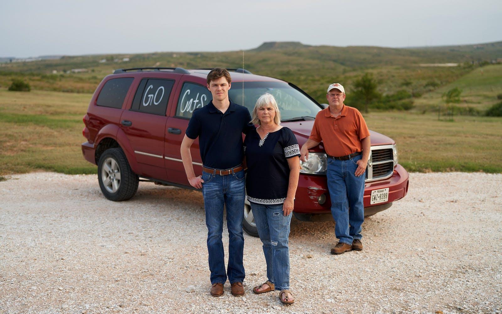 Tucker Brown, Penny Meek, and Chris Meek with Tom's Durango.