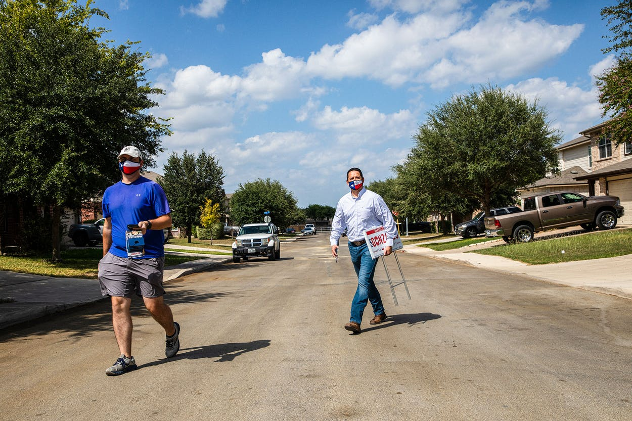 Republican congressional candidate Tony Gonzales (right) and his campaign manager, Michael Blair, going door-to-door in San Antonio in September.