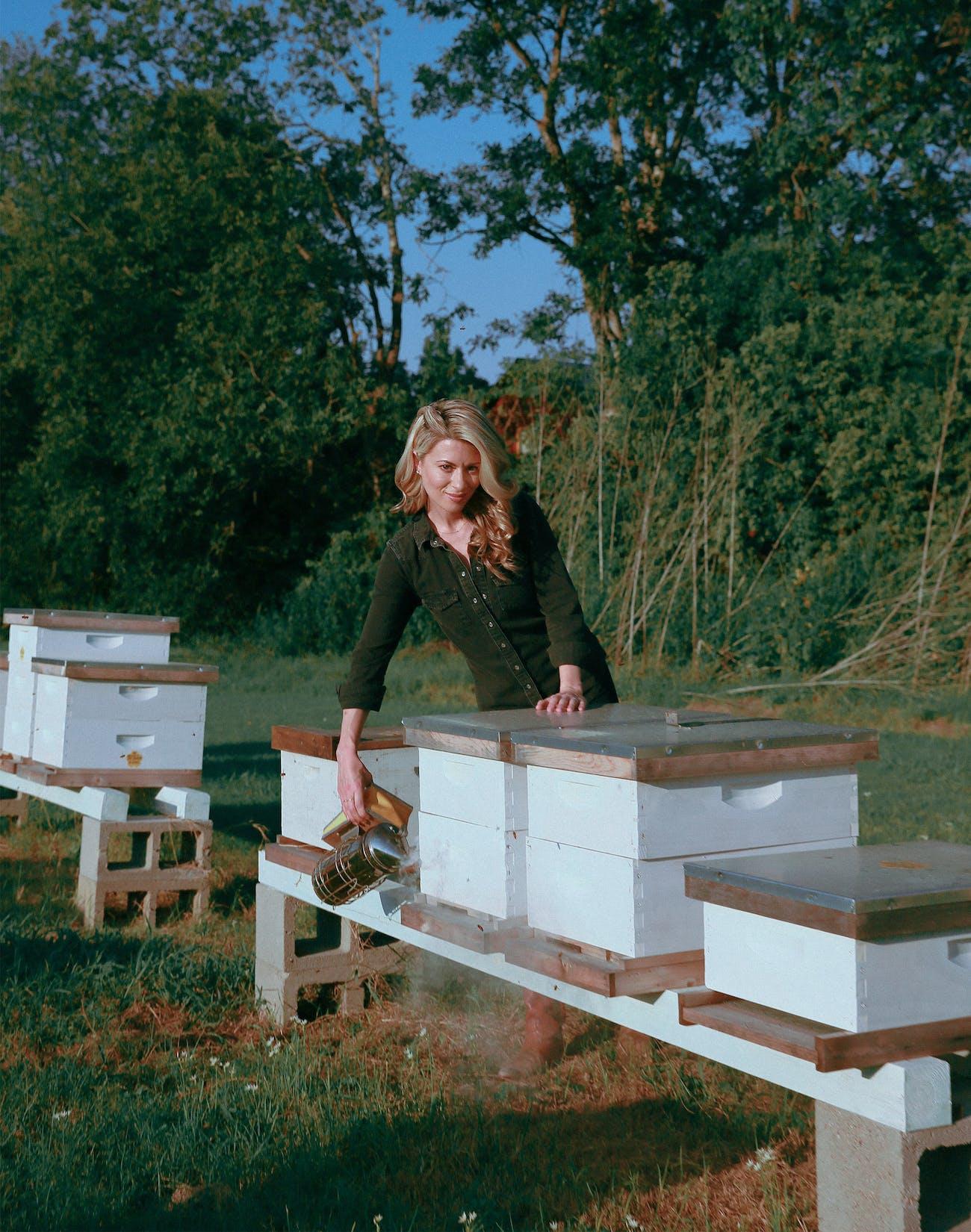 Erika Thompson tending to her bees outside her home in Elgin on September 18, 2020.