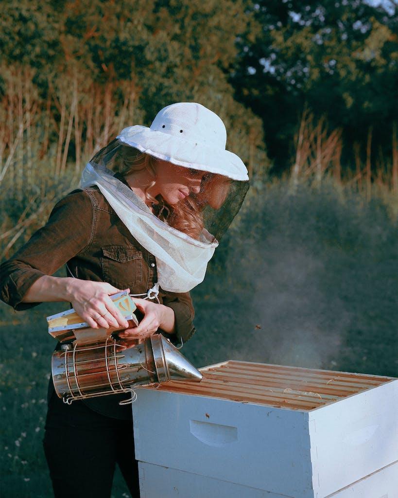 Erika Thompson tending to her bees outside her home on September 18, 2020.