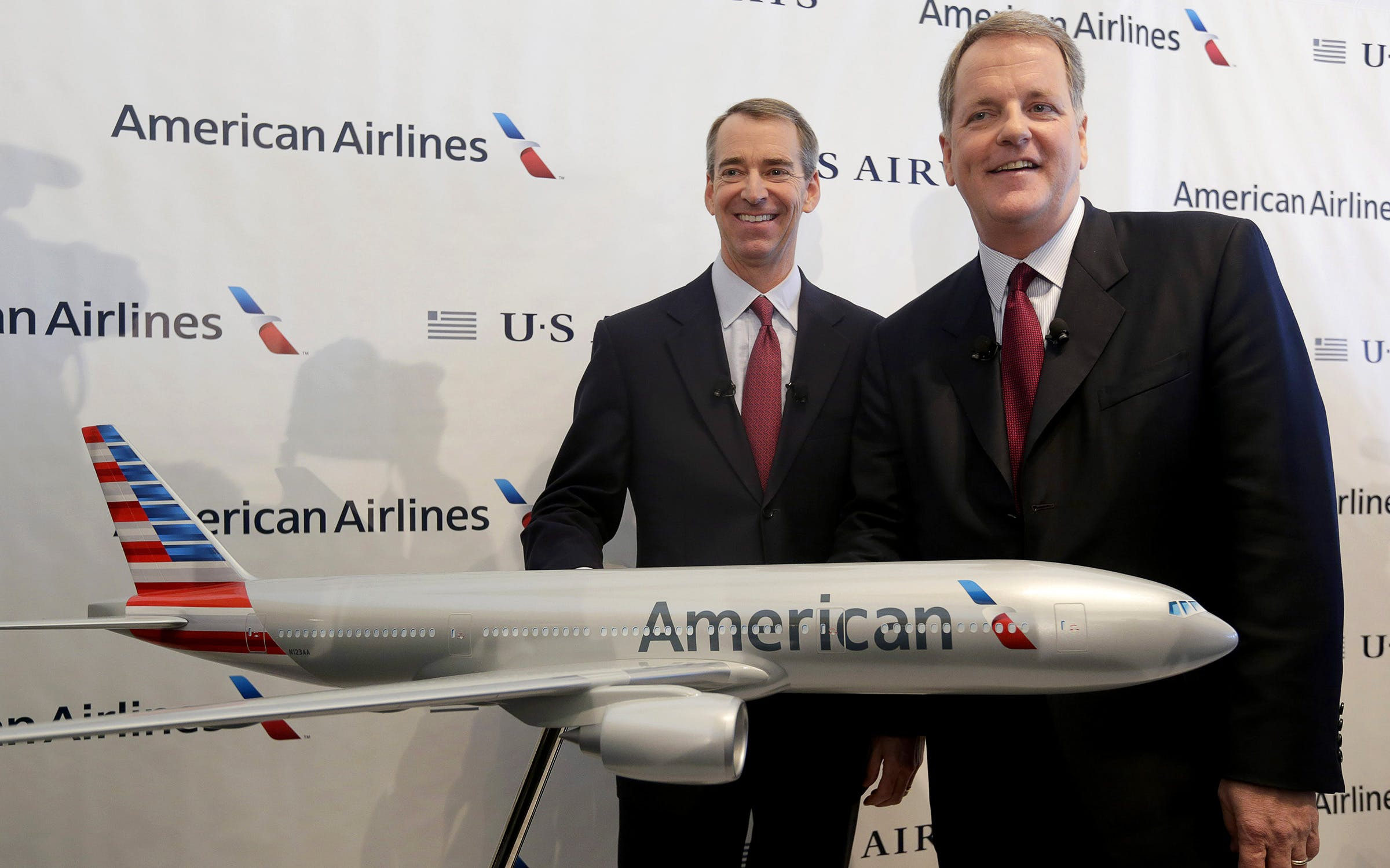 U.S. Airways CEO Doug Parker, right, and American Airlines CEO Tom Horton pose after a news conference at DFW International Airport Thursday, Feb. 14, 2013, in Grapevine, Texas. The two airlines will merge forming the world's largest airlines.