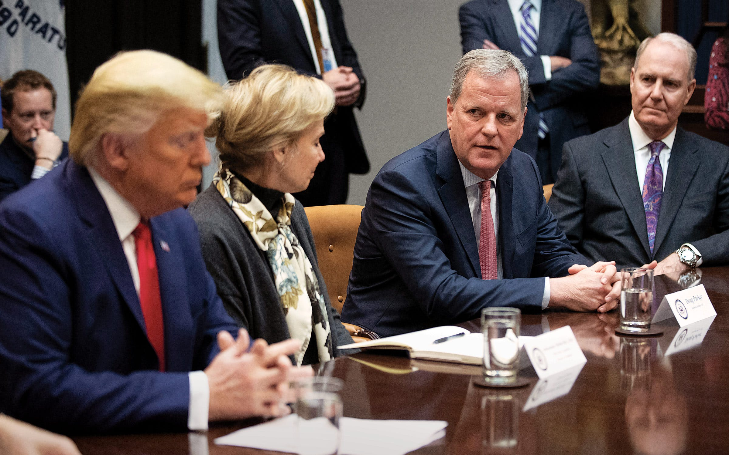 American CEO Doug Parker, second from right, with Southwest CEO Gary Kelly, right, at the White House on March 4, 2020.
